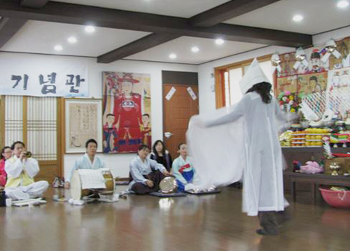 Cheryl Pallant dancing in shaman ceremony in S. Korea