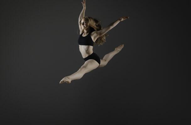 Zahna Simon leaping through the air