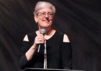 Debra Cash at podium