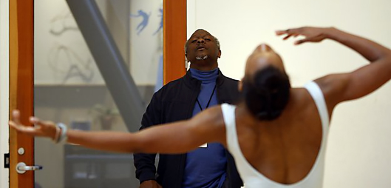 Robert Moses and dancer Crystaldawn Bell in rehearsal, photo by Steven Disenhof