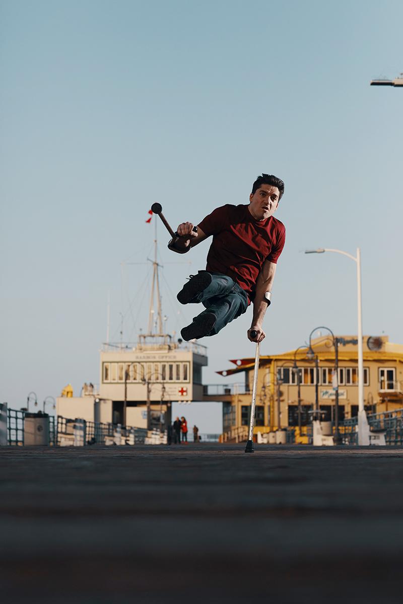 Luca Patuelli breakdancing near a pier