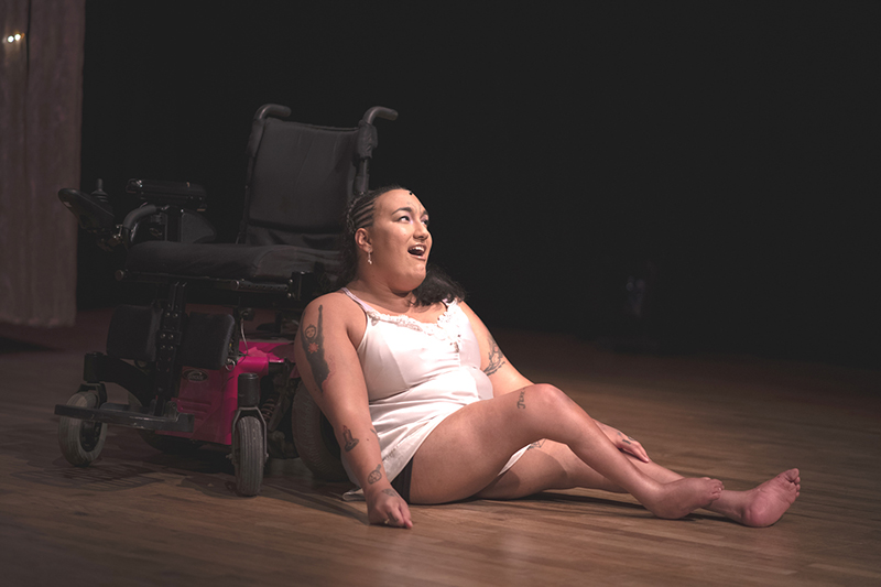 NEVE leaning against a wheelchair