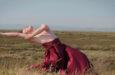 Sean Dorsey dancing in a field
