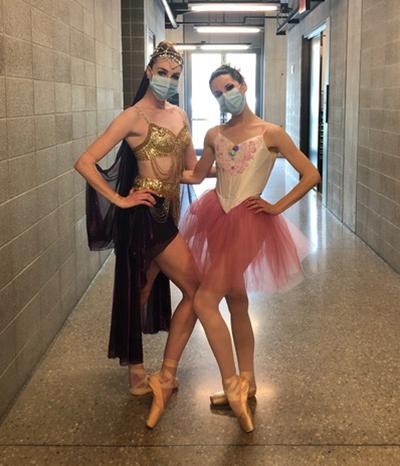 Two ballet dancers posing in costume