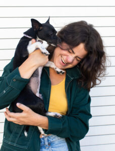 Courtney King holding small dog