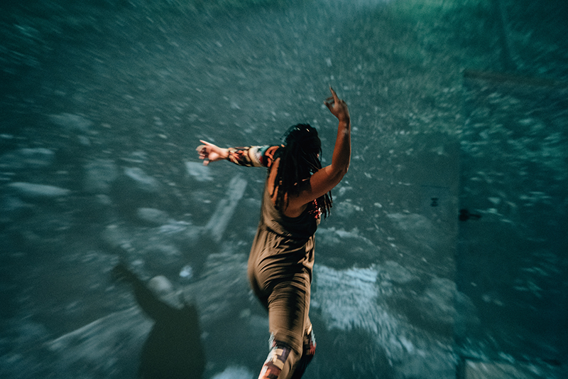 Cherie Hill dancing with turquoise backdrop