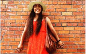 Felicitas Fischer standing against a brick wall
