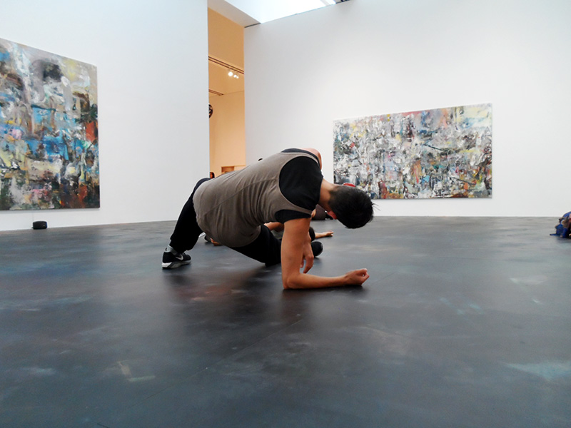 Hope Mohr dancing on the floor of an art gallery