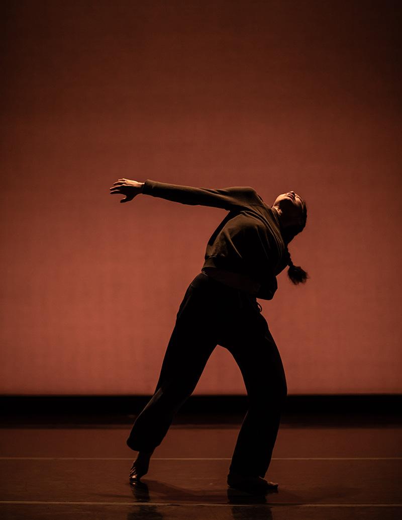 Karla Quintero dancing with orange background