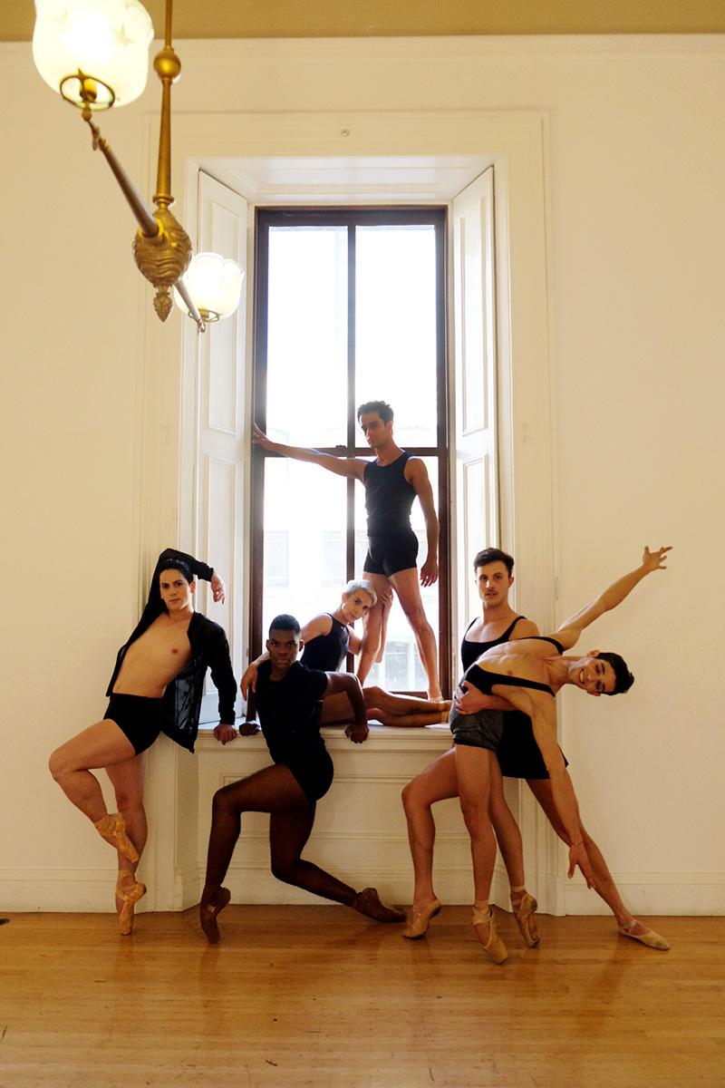 five mxn dancers en pointe in a window