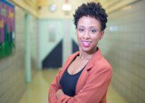 Rachel McCaulsky smiling in a hallway