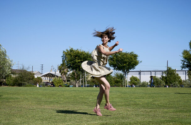 Brittany Delany whirling in park