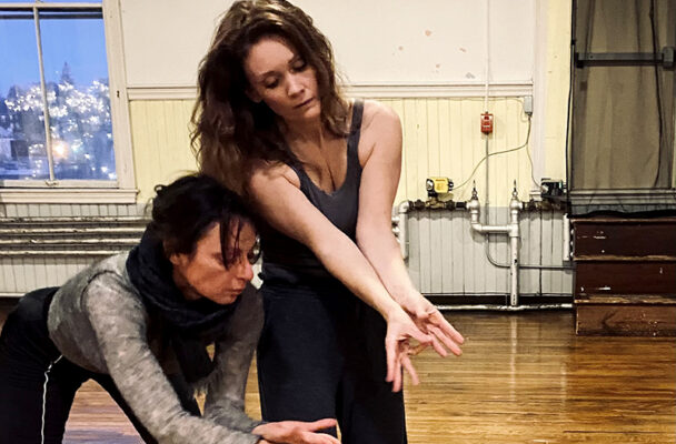 Michaela Knox and another dancer with their arms extended in front of them